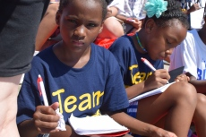 A young girl at the organization Mighty Writers' attempt to break a Guinness World Record during July. | THE TEMPLE NEWS