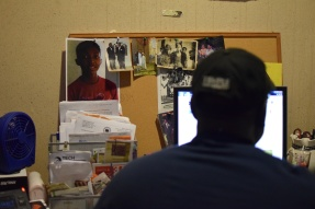 Community resident Greg Bonaparte is a general mechanic in 1300 Residence Hall. Photos of friends and family hang in his office in the hall's basement. | THE TEMPLE NEWS