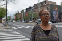 Dorin Collins grew up in North Philadelphia and tried her first cheesesteak at a shop on Broad Street near Diamond, seen behind her. The shop is now gone, and a fraternity stands in its place. | THE TEMPLE NEWS