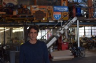 Adam Cramer stands in the shop where he has fixed vintage motorcycles for 15 years.   PERSONAL
